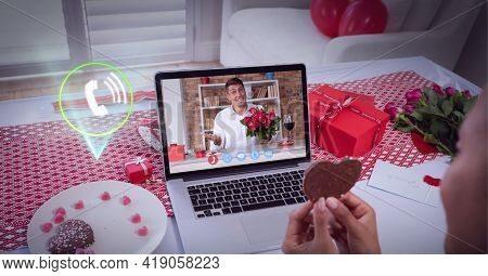 Composition of digital interface with call icon over man with roses on valentine's day on laptop. global networking, romance, love, communication and technology concept digitally generated image.