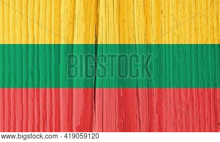 The Flag Of Lithuania On Dry Wooden Surface, Cracked With Age. Light Pale Faded Paint. Background, W