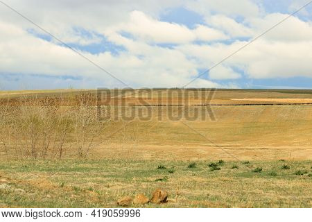 Rural Grasslands On A Windswept Prairie Surrounded By Storm Clouds During A Rain Shower Taken At A G