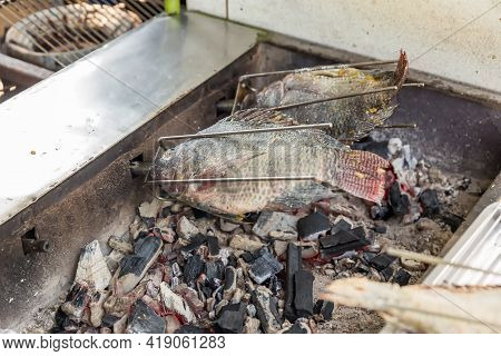 Tilapia Fish With Salt And Then Burned For Sales In The Market. (thai Style Street Food.)  Grilled F