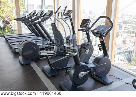 Sports Equipment In The Gym. Modern Gym Interior With Equipment. Cardio Machine In Gym With Modern F