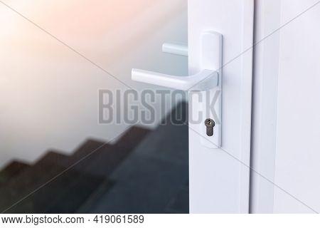 Exterior Door Handle And Security Lock On Metal Frame. Aluminum Door Knob. Modern White  Door With M
