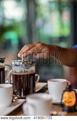 Hand Preparing Coffee In French Press Coffee Maker. Morning Concept. Coffee Siphon. Spent Coffee Bre