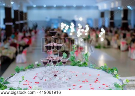 Champagne Glass Pyramid. Pyramid Of Glasses Of Wine, Champagne, Tower Of Champagne\'s Glass In Weddi