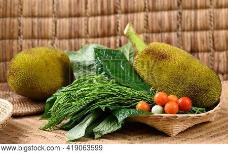 Young Jackfruit And Local Vegetables In A Basket, Food Ingredients For Northern Thai Food (kang Kano