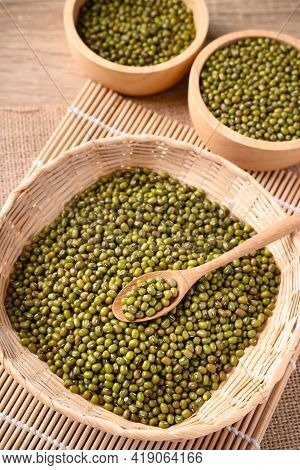 Mung Bean Seeds In Wooden Spoon And Bamboo Basket, Food Ingredients In Asian Cuisine And Produce Mun