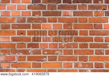 Brick Red Wall. Background Of A Old Brick House.