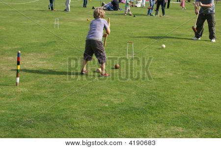 Child Playing Croquet