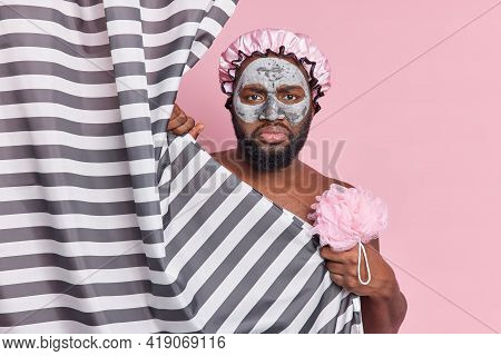 Dissatisfied Afro American Man With Fresh Dark Skin Takes Care Of Body And Skin Takes Shower Regular