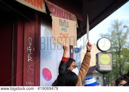 Berlin, Germany - May 01, 2021: A Protester Holding A Placecard Saying