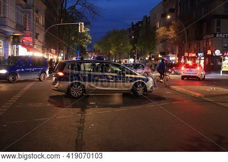 Berlin, Germany - May 01, 2021: Police Car At An Intersection In The Evening At 1st May Demonstratio