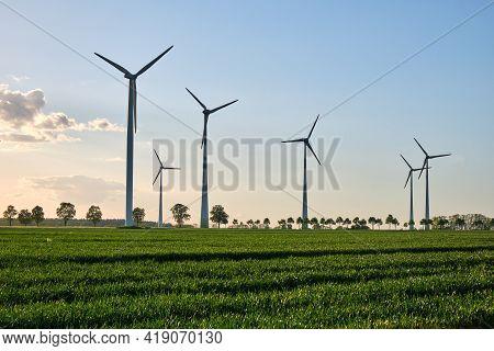 Wind Turbines In A Grain Field With Back Light Seen In Germany