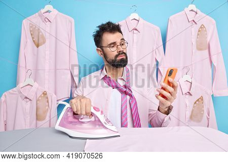 Serious Bearded Businessman Dresses For Work Checks Newsfeed On Mobile Phone Wears Shirt With Tie Ir