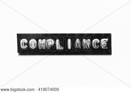 Embossed Letter With Word Compliance In Black Banner On White Paper Background