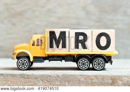 Toy Truck Hold Alphabet Letter Block In Word Mro (abbreviation Of Maintenance, Repair And Overhaul O