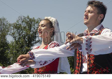 Chisinau, Moldova - July 11, 2015: Young Dancers In National Costume Dancing A Moldovan Folk Dance