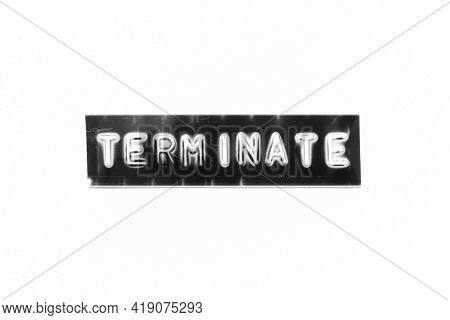 Embossed Letter With Word Terminate In Black Banner On White Paper Background