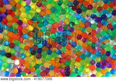 Abstract Multicolored Light Background With Hydrogel Pearl Texture