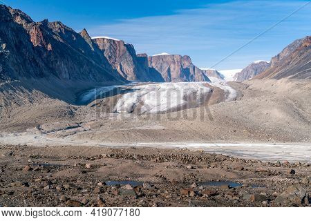 Sun Shines Above Remote Arctic Valley Of Akshayuk Pass, Baffin Island, Canada. Blue Sky Above Highwa
