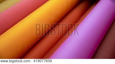 Close-up Multicolored Textile Linen Rolls In Pink, Orange, Purple Colors. E-commerce, Offline Sale,