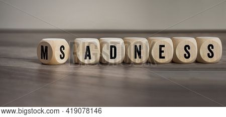 Cubes, Dice Or Blocks With Madness And Sadness On Wooden Background