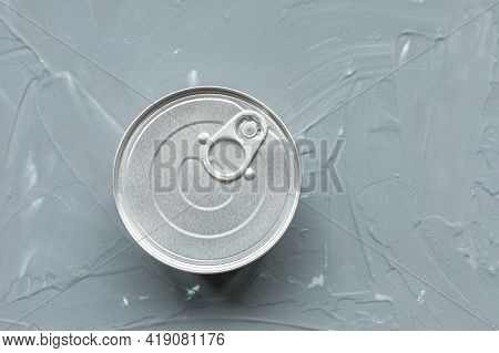 One Tin Canned Food, No Label On Gray Background. Provisions Or Cat Food Concept. Close Up, Top View