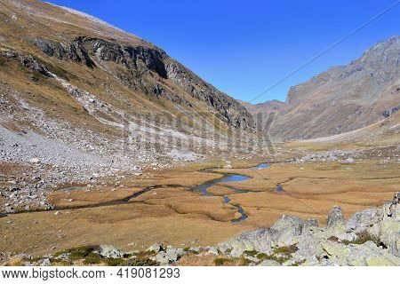 View On River  In Vanoise National Park In France Crossing Yellow Grass In Alpine Meadow Mountain  U