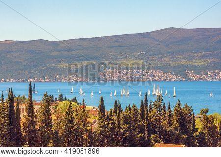 Beautiful  Sunny Mediterranean Landscape. Sailboats On Water. Montenegro, Adriatic Sea, View Of Bay