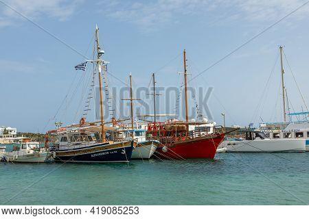 Antiparos Island, Greece - 28 September 2020: Boats And Sailing Ship Moored At The Harbor Wharf. Whi