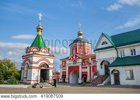 Buildings Of Kizichesky Monastery, Kazan, Russia. Colorful Chapel Is On Foreground, Red Church Of St