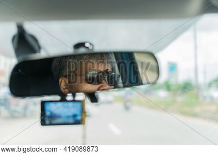 Smart Older Woman Driving Car With Video Recorder Drive View Mirror On Highway, Dash Cam Digital For