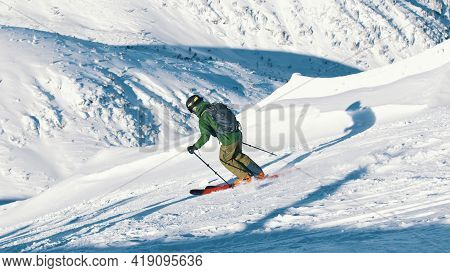 Kasprowy Wierch, Poland 28.01.2021 - Skier On A Sloppy Mountain On A Bright Sunny Day - Skiing . Hig