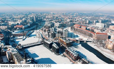 Snow-covered Streets In The City Of Wroclaw, Poland. Winter Season. Old Town And Buildings. City Sky