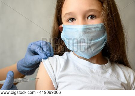 Vaccination Of Kid From Covid-19 Or Flu, Pretty Little Girl Looks At Camera During Coronavirus Vacci