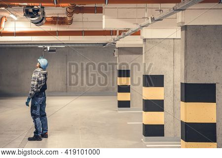 Caucasian Air Ventilation Technician In His 40s Checking On New Underground Garage Polluted Air Remo