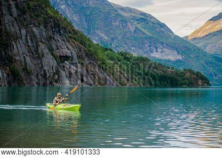 Caucasian Men In A Kayak On Glacial Lake In The Norway Exploring Fascinating Norwegian Nature From T