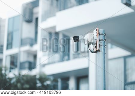 Cctv. Video Surveillance Camera Is Mounted On A Pole Outside An Apartment Building For Monitor Secur