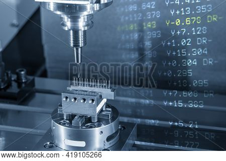 The Abstract Scene Of  Hi-precision Cnc Milling Machine Cutting The Copper Material And G-code Data