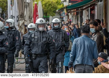 Hamburg, Germany - May 1, 2021: Riot Police Patrol On The Side Of A Demonstration With Helmets On Du