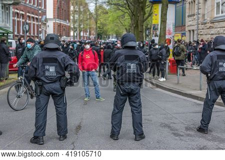 Hamburg, Germany - May 1, 2021: Left-wing Protester With Socialist, Communist Hammer And Sickle Hood