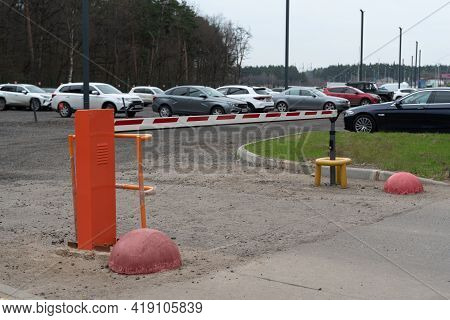 Security Barrier Of A Parking Lot. Closed Passage.