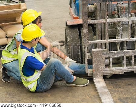 Accident Of Working Man, Forklift Over Leg Of Engineer. Asian Engineer Worker Man Was Crushed By A F