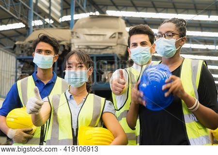 Men And Woman Work Together, Wear Safety Facemask And Giving Thumbs Up. Caucasian Engineer Men, Asia
