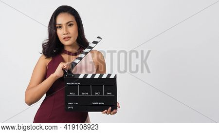 Asian Woman Is Holding Clapper Board Or Movie Slate Use In Video Production ,film, Cinema ,movies In