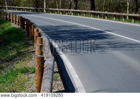 Road Barriers Resembling Railings Made Of Solid Wooden Beams And Trunks, Rods. Inside The Wooden Bea