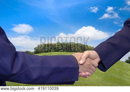Business Handshake Land Purchase. Building Land For New Construction Project On Green Meadow, Plot F