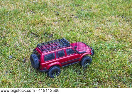 View Of Radio Controlled Model  Racing Car On Off-road Background. Toys With Remote Control. Free Ti