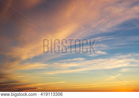 Dramatic Majestic Clouds On Blue Sky With Yellow Pink Tones In Sunset Light, Beautiful Scenic Clouds