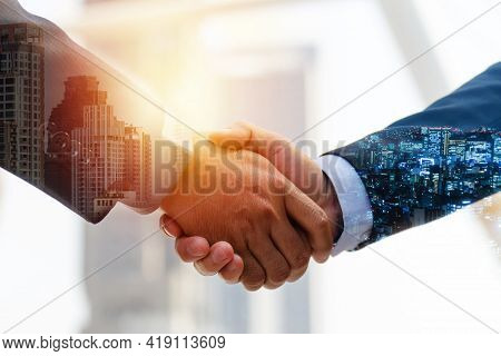 Investor. Double Exposure Image Of Investor Business Man Handshake With Partner For Successful Meeti