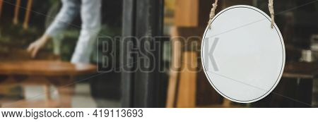 Panpramic Wide Banner. Blank Vintage Wooden Sign Board Hanging On Glass Door In Modern Cafe Restaura